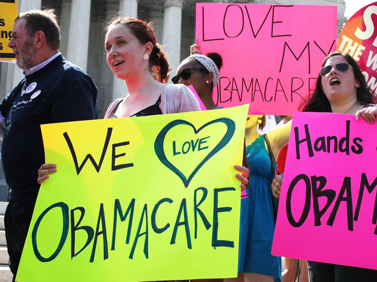 File Photo: Obamacare supporters demonstrate in front of the U.S. Supreme Court June 28, 2012 in Washington, DC. The Supreme Court is expected to hand down its ruling on the Affordable Healthcare Act this morning.  (Photo by Alex Wong/Getty Images/File)