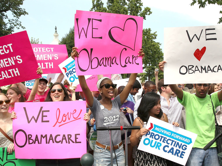 File Photo: Obamacare supporters react to the  U.S. Supreme Court decision to uphold President Obama's health care law, on June 28, 2012 in Washington, DC. Today the high court upheld the whole healthcare law of the Obama Administration.  (Photo by...