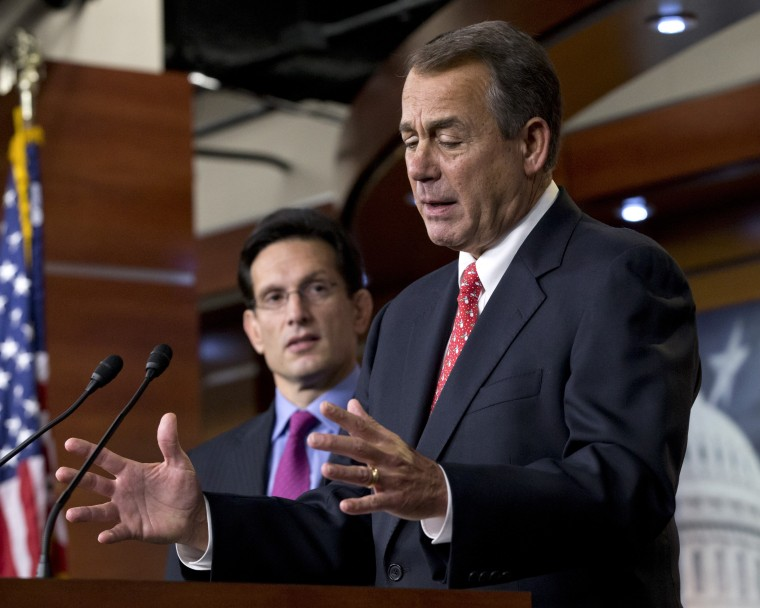 Speaker of the House John Boehner, R-Ohio, joined by House Majority Leader Eric Cantor, R-Va., left, speaks to reporters about the fiscal cliff negotiations at the Capitol in Washington, Friday, Dec. 21, 2012. (Photo by J. Scott Applewhite/AP Photo)