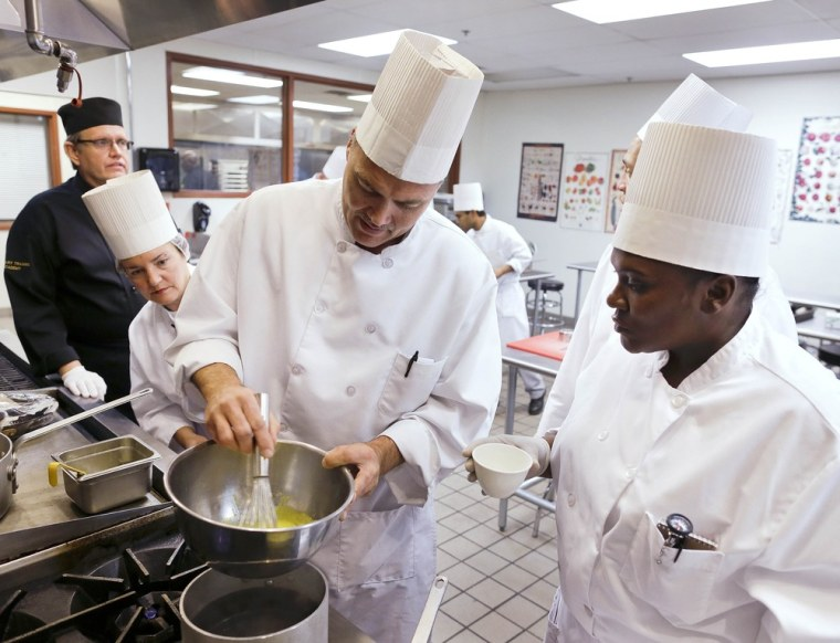 Students in a professional cook class make hollandaise sauce as instructor Larry Baumann, far left, looks on at the Culinary Academy of Las Vegas, Friday, Dec. 14, 2012, in Las Vegas. The academy is funded through a trust created by the culinary and...