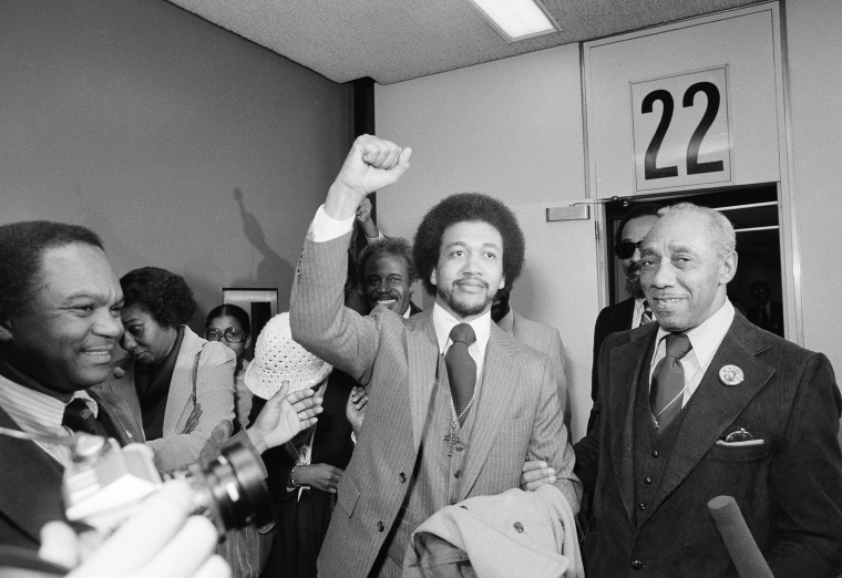The Rev. Benjamin  Chavis gives a clenched fist salute on December 14, 1979, after being paroled by then-North Carolina governor Jim Hunt. Chavis, one of the Wilmington 10 defendants, was pardoned on Monday by North Carolina's current governor, Bev...