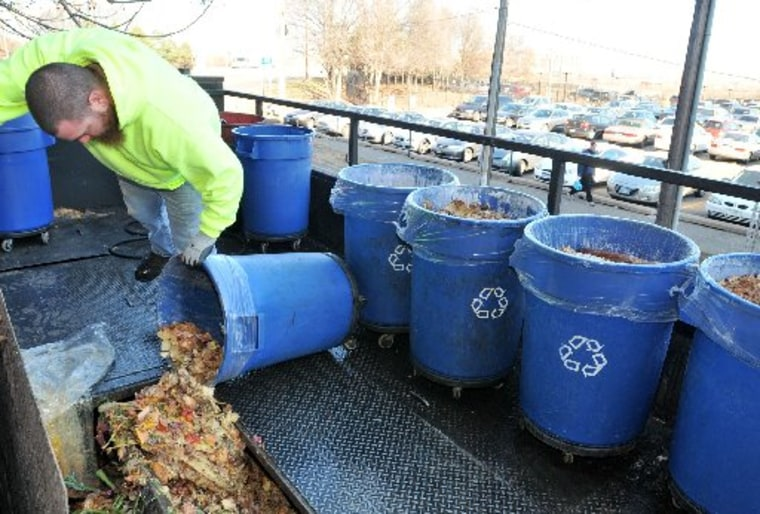 File Photo: Barthold Recycling driver Erick Krotzer fills the inside of his truck, through a trapdoor on top of the vehicle, with food scraps from Heartland Restaurant in downtown St Paul, Minn. on Thursday, Nov. 15, 2012. The pampered pigs served by...