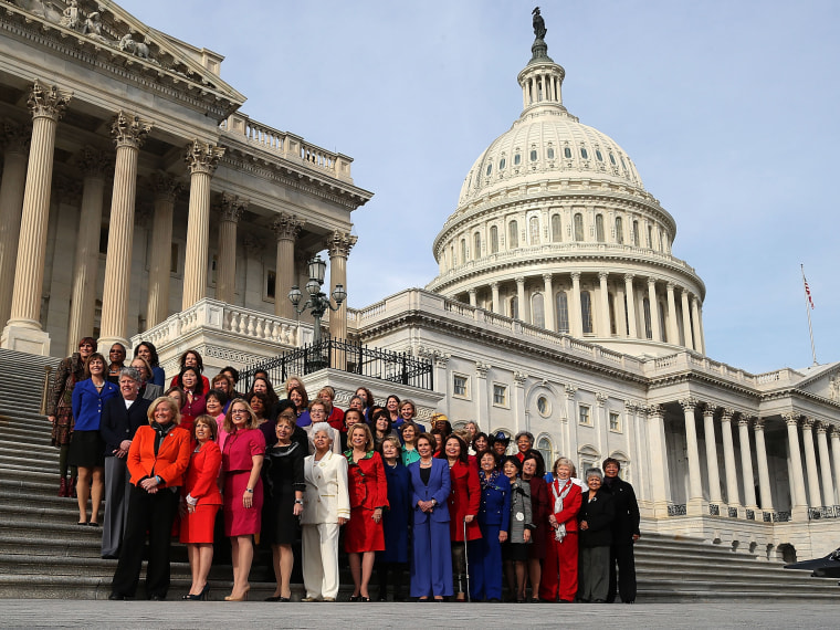 Democratic Leader Nancy Pelosi (D-CA) (C), stands with the Democratic women of the House to highlight the historic diversity of the House Democratic Caucus, on January 3, 2013 in Washington, DC. The new 113th Congress will be sworn in today.  (Photo by...