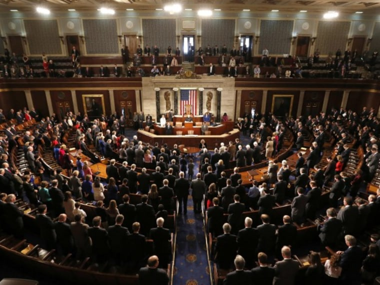 """Members of the 113th Congress bow their heads in prayer as they convene in the Capitol in Washington January 3, 2013. In the wake of bruising fights in their own ranks over the \""""fiscal cliff\"""" and aid for victims of superstorm Sandy - Republicans in the..."""