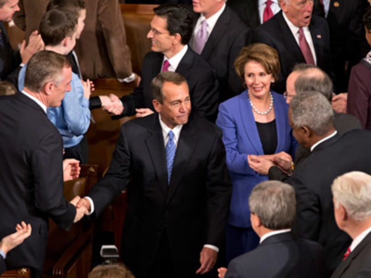 House Speaker John Boehner of Ohio being greeted by colleagues on Capitol Hill in Washington on Thursday after surviving a roll call vote in the newly convened 113th Congress. (Photo by J. Scott Applewhite/AP Photo)