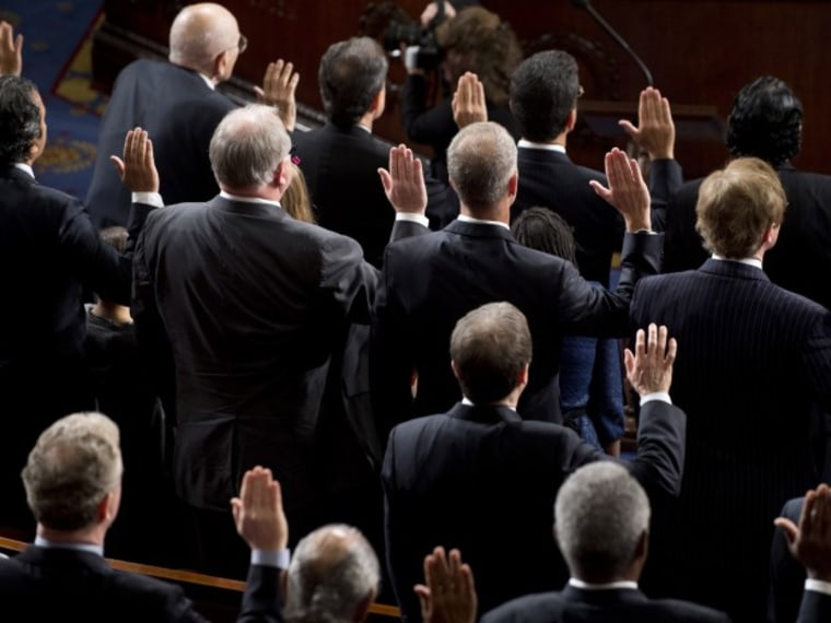 Members of the 113th US House of Representatives take their oath as they are sworn in during the opening session at the US Capitol in Washington, DC, on January 3, 2013. (Photo by Saul Loeb/AFP/Getty Images)