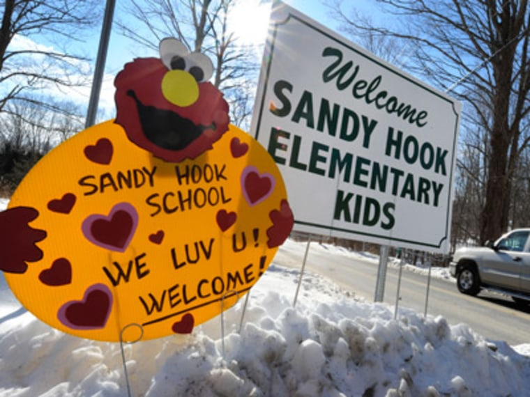 A sign welcomes Sandy Hook Elementary school children on their first day of classes near the former Chalk School in Monroe, Conn. on Thursday. (Photo by Jessica Hill/AP Photo)