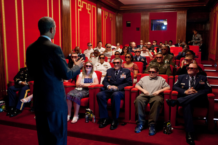 """May 25, 2012 - """"The President was welcoming service members and their families to a screening of 'Men in Black 3' in the White House Family Theater. The movie was being presented in 3D, so the President jokingly asked them to try on their 3D glasses..."""