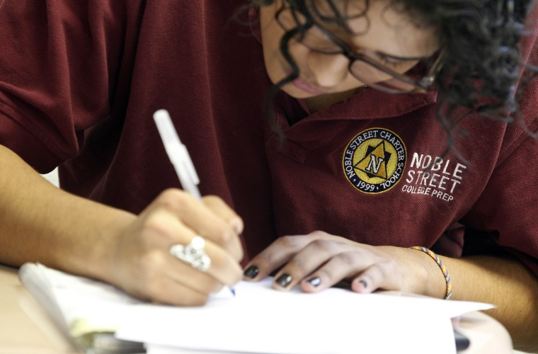 A student at Noble Street College Prep does classwork at the school in Chicago in February. (AP Photo/M. Spencer Green)