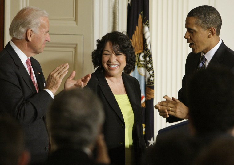 President Barack Obama and Vice President Joe Biden applaud federal appeals court judge Sonia Sotomayor, after the president announced her as his nominee to the Supreme Court (Photo by Alex Brandon/AP)