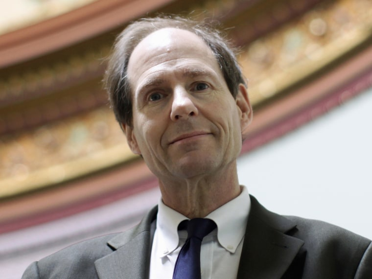 File Photo: In this photo taken March 16, 2011, Cass Sunstein, Director of the Office of Information and Regulatory Affairs at the Office of Management and Budget, poses for a photo at the Eisenhower Executive Office Building across from the White...