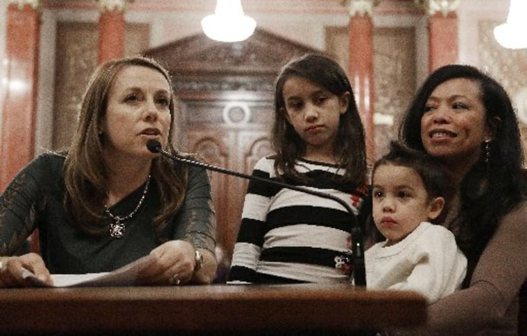 Theresa Volpe, left, testifies along side of her daughter Ava as her partner Mercedes Santos sits with their son Jaidon during a Senate Executive committee hearing considering same sex marriage at the Illinois State Capitol Thursday, Jan. 3, 2013 in...