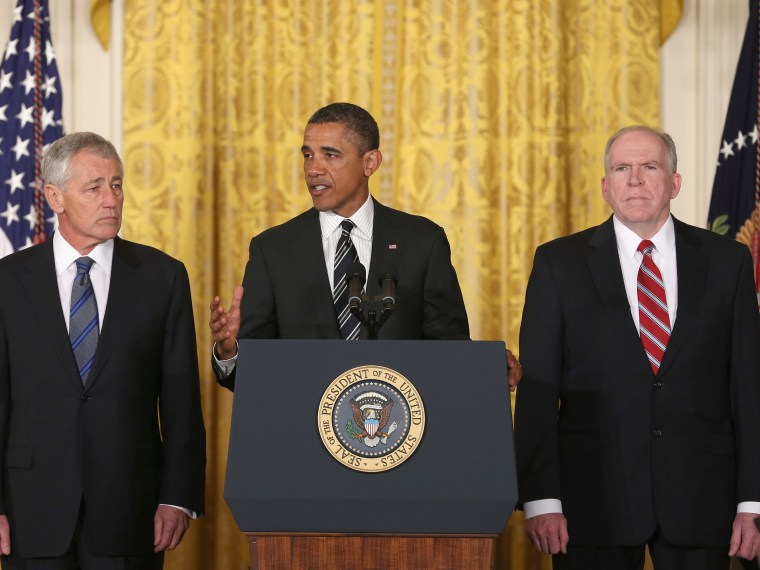 U.S. President Barack Obama (C) speaks during a news conference with chief counterterrorism adviser John Brennan (L), and former U.S. Sen. Chuck Hagel (R-NB) in the East Room at the White House on January 7, 2013 in Washington, DC. Pending approval by...