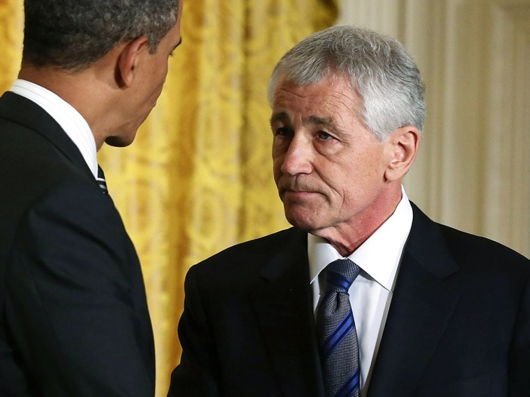 President Barack Obama shakes hands with former U.S. Sen. Chuck Hagel in the White House. Obama has nominated Hagel for the next Secretary of Defense. (Alex Wong / Getty Images)