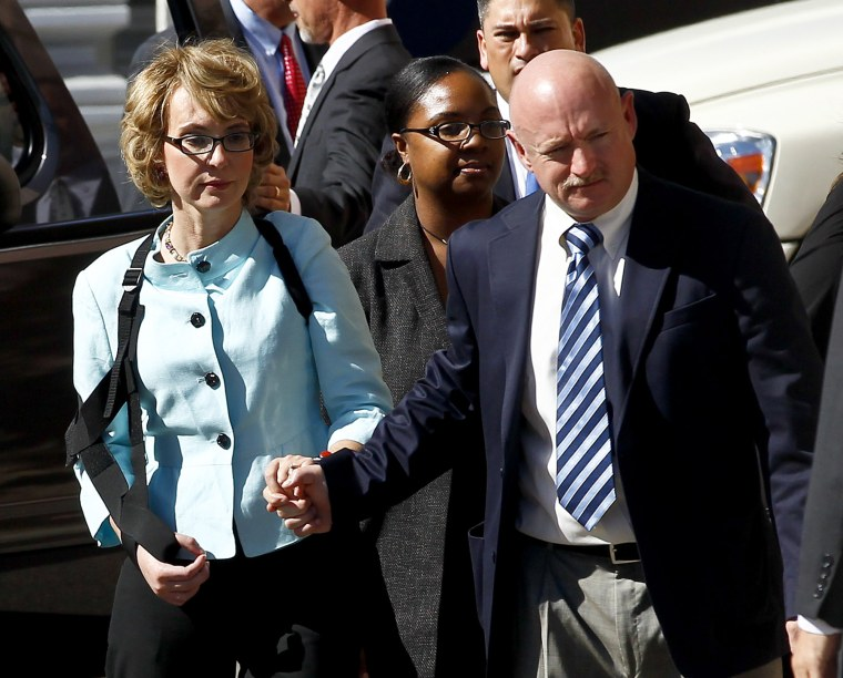 File Photo: Former Democratic Rep. Gabrielle Giffords, left, and her husband Mark Kelly leave after the sentencing of Jared Loughner, in back of U.S. District Court Thursday, Nov. 8, 2012, in Tucson, Ariz. Giffords and Kelly launched a political action...