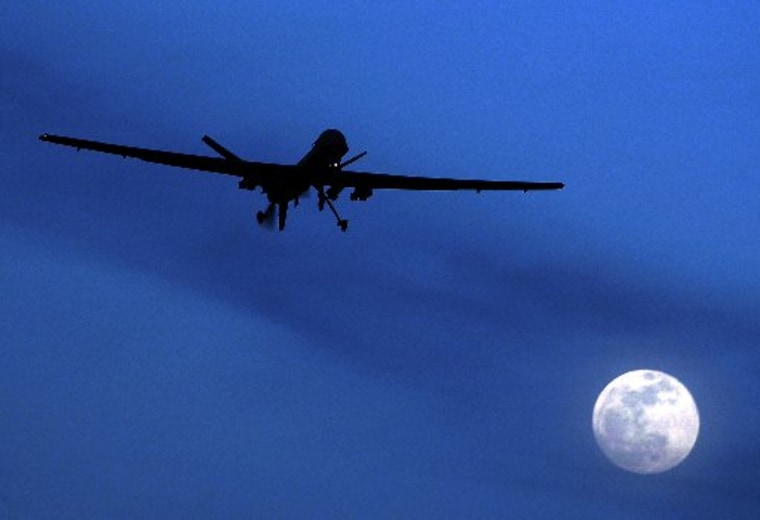 A U.S. Predator drone flies over the moon above Kandahar Air Field, southern Afghanistan. (Photo by Kirsty Wigglesworth/AP)