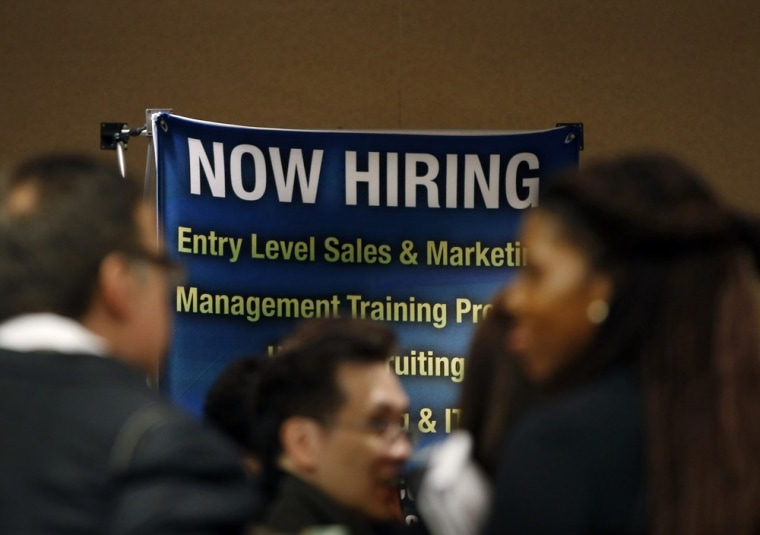 Job seekers stand in line to meet with prospective employers at a career fair in New York City in this file photo taken October 24, 2012.(REUTERS/Mike Segar)