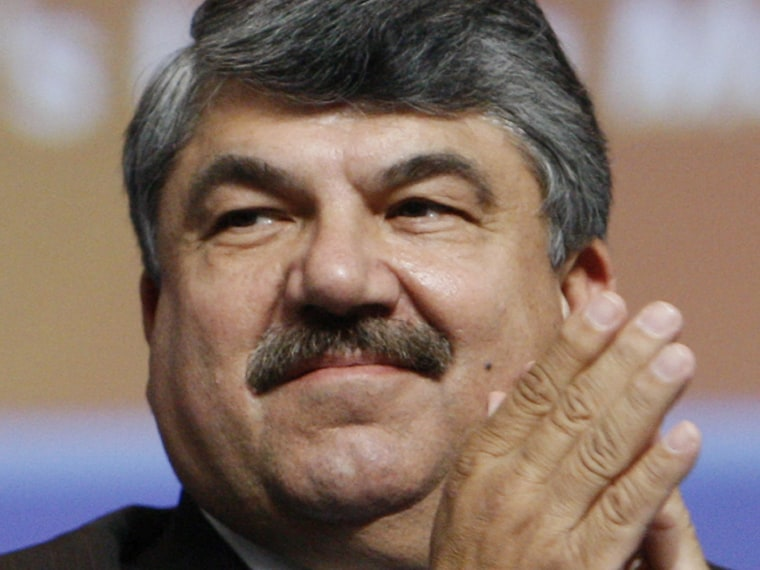File Photo: In this Sept. 15, 2009 photo, AFL-CIO President Richard Trumka applauds at the David L. Lawrence Convention Center in Pittsburgh. (Photo by Charles Dharapak/AP Photo/File)