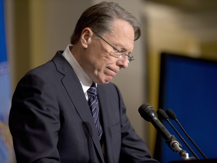 National Rifle Association executive vice president Wayne LaPierre pauses as he makes a statement during a news conference in response to the Connecticut school shooting, on Dec. 21, 2012 in Washington, D.C. (Photo by Evan Vucci/AP)