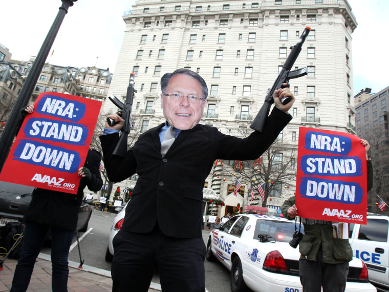 "Members of the activist group Avaaz protest today's NRA press conference with a likeness of NRA CEO Wayne LaPierre Jr., calling on NRA affiliates like Days Inn and Super 8 to get ""out of bed"" with the gun lobby, outside the Willard Hotel in Washington,..."