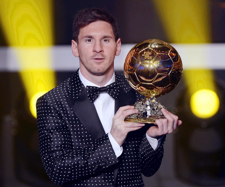 FC Barcelona's Argentinian striker Lionel Messi poses with the trophy after being awarded the FIFA Men's World Player of the Year during the FIFA Ballon d'Or Gala 2012 held at the Kongresshaus in Zurich, Switzerland, Monday,  Jan 7, 2013. Messi was...