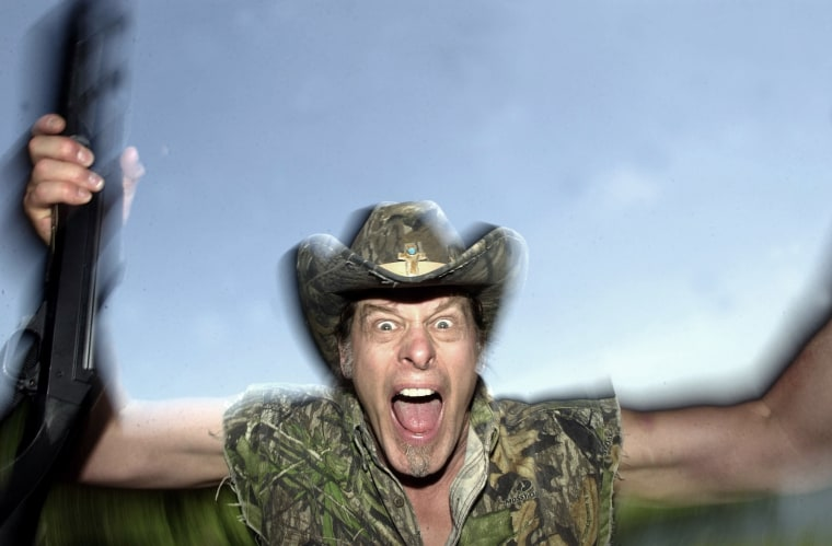 In this file photo Ted Nugent screams for a photo at his ranch near Crawford, Texas, Friday,  April 22, 2005.  (Photo by LM Otero/AP File)