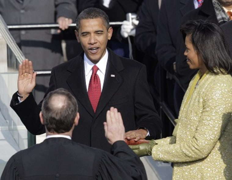 Barack Obama, joined by his wife Michelle, takes the oath of office from Chief Justice John Roberts to become the 44th president of the United States at the U.S. Capitol in Washington, D.C., in this Jan. 20, 2009 file photo. (Photo by Jae C. Hong/AP...