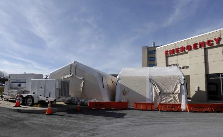 """A tent is set up for a patients with flu symptoms, just outside the emergency entrance at the Lehigh Valley Hospital Thursday, Jan. 10, 2013, in Allentown, Pa. The Pennsylvania Department of Health designated flu as now """"widespread"""" throughout the..."""