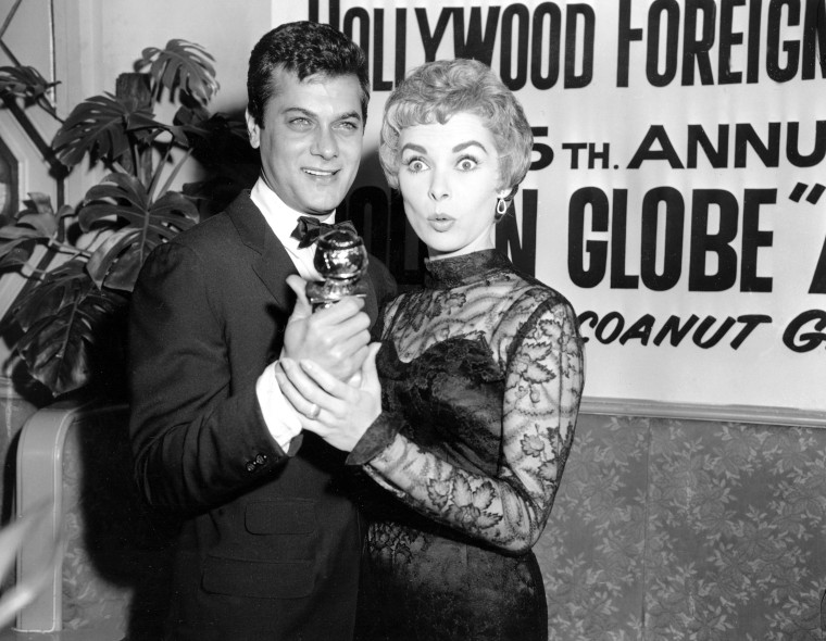 Tony Curtis holds his Golden Globe award for World Male Film Favorite as his wife, actress Janet Leigh, gives a look of surprise at the Hollywood Foreign Press Association awards dinner at the Coconut Grove in Hollywood, Calif., Feb. 26, 1958. Curtis...