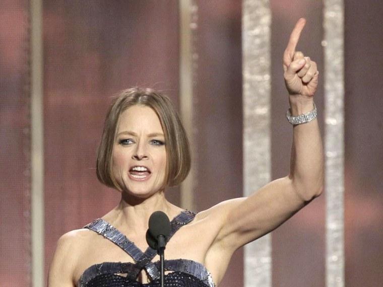 A handout picture provided by NBC Universal on 13 February 2013 shows US actress Jodie Foster receiving the Cecil B. Demille award from US actor Robert Downey Jr (R) during the 70th annual Golden Globe Awards held at the Beverly Hilton Hotel, in...