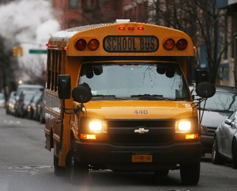 A school bus drives down a street in Manhattan's East Village on January 15, 2013 in New York City. (Photo by Mario Tama/Getty Images)