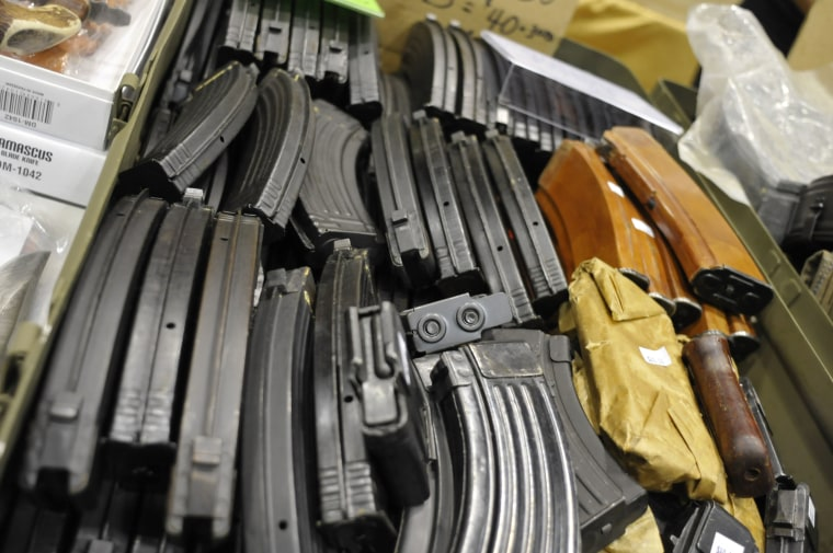AK-47 assault rifle magazines fill a box at a gun and knife show in White Plains, N.Y., Saturday, June 19, 2010. (AP Photo/Swoan Parker)