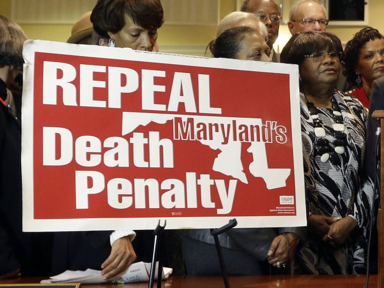 Maryland Gov. Martin O'Malley, center, speaks at a rally in support of repealing the state's death penalty in Annapolis, Md., Tuesday, Jan. 15, 2013. O'Malley, who said he will be making repeal a priority, argued that the death penalty is a waste of...
