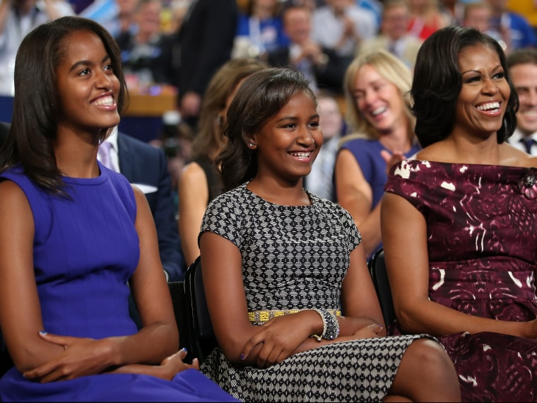File photo: Malia Obama, Sasha Obama and first lady Michelle Obama listen as President Obama speaks at the DNC in Charlotte, North Carolina on September 6, 2012.  (Photo by Chip Somodevilla/Getty Images)