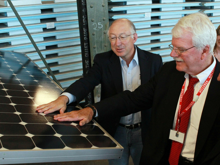 File Photo:  U.S. Secretary of the Interior Ken Salazar (L) and U.S. Rep. George Miller (D-CA) touch a solar panel as they tour Sunpower Corporation's research and development facility October 14, 2010 in Richmond, California. Salazar signed a Record...