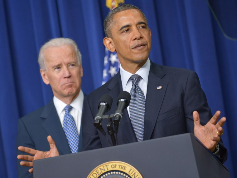 US President Barack Obama speaks on proposals to reduce gun violence as Vice President Joe Biden watches on January 16, 2013 in the South Court Auditorium of the Eisenhower Executive Office Building, next to the White House in Washington, DC. President...