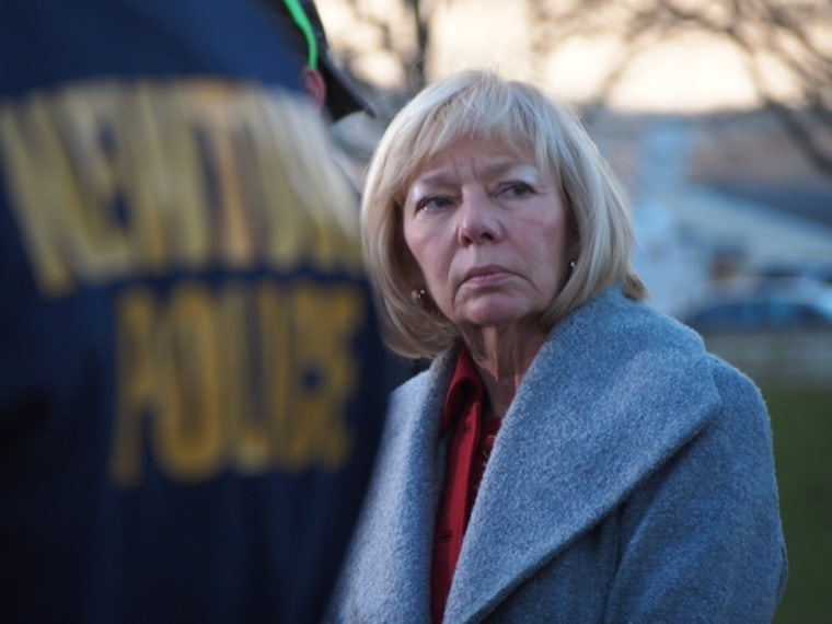 Newtown Superintendent of Schools Janet Robinson, in the background, was among officials at a press conference at Treadwell Park in Newtown on Dec. 14, 2012, in the wake of a shooting at Sandy Hook School that claimed the life of 26, including 20...