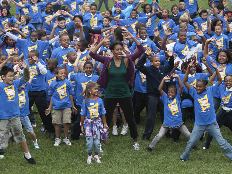 First lady Michelle Obama hosts local children on the South Lawn of the White House in Washington, Tuesday, Oct. 11, 2011, as they attempt to break the Guinness World Records title for the most people doing jumping jacks in a 24-hour period. (Photo by...