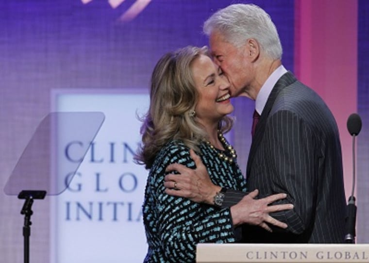 Bill Clinton kisses his wife, Secretary of State Hillary Clinton, as he introduces her at the Clinton Global Initiative in New York on September 24, 2012. (Photo by Lucas Jackson/Reuters/File)
