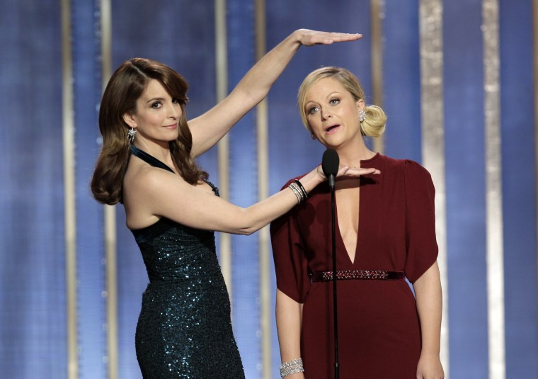 Comedians Tina Fey, left, and Amy Poehler during their opening monologue at the 70th annual Golden Globes Sunday night. (AP Photo/NBC, Paul Drinkwater)