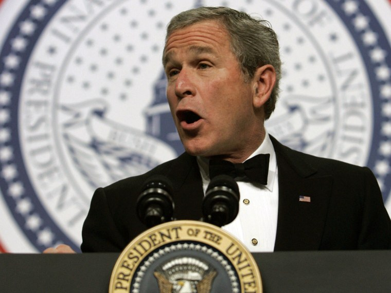 File Photo: US President George W. Bush addresses the Texas Wyoming Ball, part of the festivities marking his inauguration for a second term, in Washington 20 January 2005.  (Photo by Brendan Smialowski/AFP/Getty Images, File)
