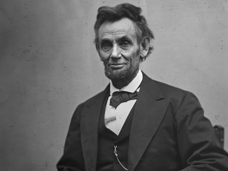 File Photo: In this photo provided by the Library of Congress, President Abraham Lincoln, seated and holding his spectacles and a pencil on Feb. 5, 1865. (Photo by Alexander Gardner/AP Photo/Library of Congress, File)