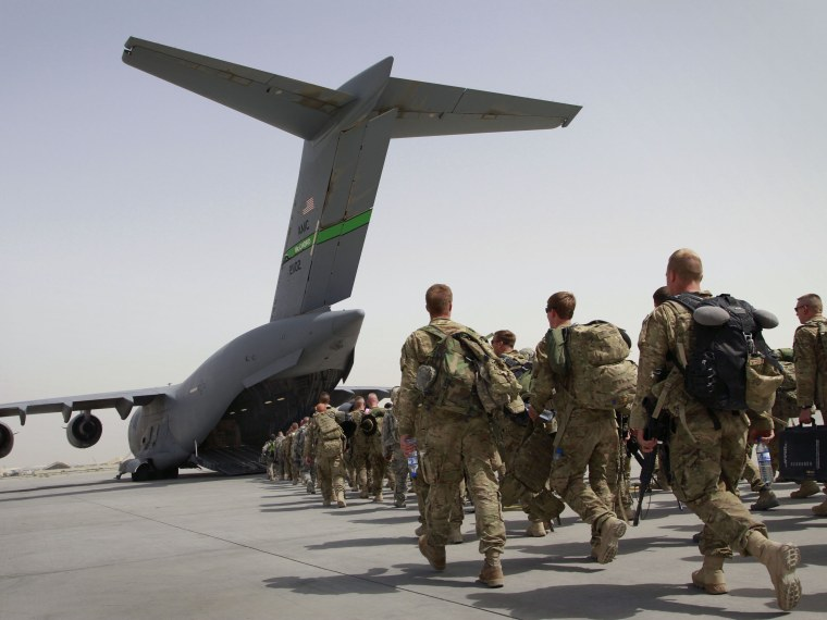 File Photo: U.S. soldiers walk to get in to a U.S. military plane, as they leave Afghanistan, at the U.S. base in Bagram, north of Kabul, Afghanistan on Thursday, July 14, 2011. (Photo by Musadeq Sadeq, AP Photo, File)