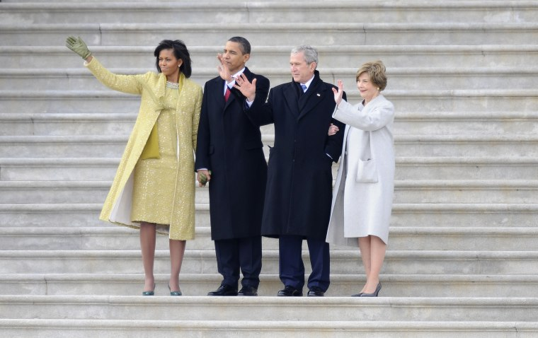 Left - right: Michelle Obama, President Barack Obama, Former President George W. Bush and Laura Bush wave as former Vice President Dick Cheney departs on the East Front of the Capitol after Obama was sworn in as the 44th President of the United States...