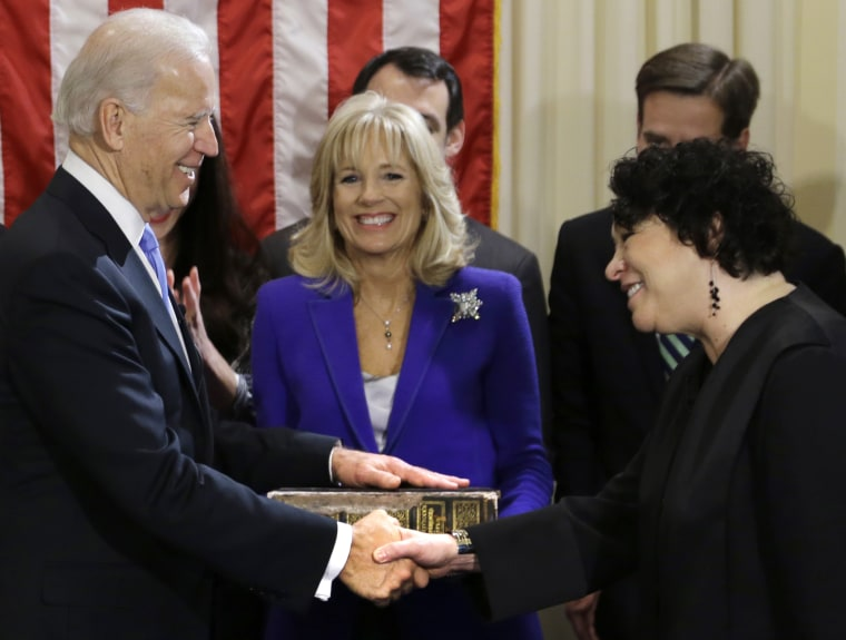 Vice President Joe Biden, with his wife Jill Biden, center, holding the Biden Family Bible, shakes hands with Supreme Court Justice Sonia Sotomayor after taking the oath of office during an official ceremony at the Naval Observatory, Sunday, Jan. 20,...
