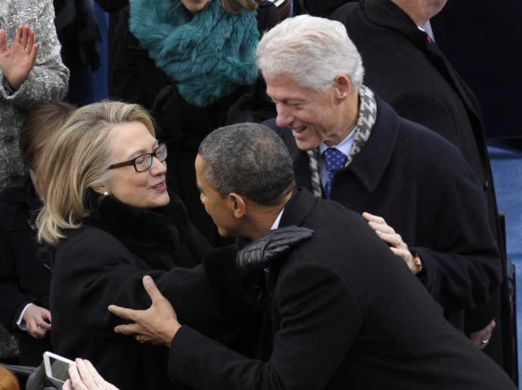 President Barack Obama is greeted by Secretary of State Hillary Clinton and former President Bill Clinton for his ceremonial swearing-in at the U.S. Capitol during the 57th Presidential Inauguration in Washington, Monday, Jan. 21, 2013. (Photo by Susan...