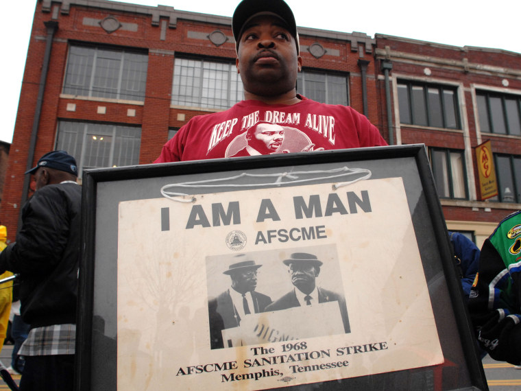 File Photo: Tim Waiters holds his uncle Jimmy's original sign from the sanitation worker's strike of 1968,  at the Recommitment March in Memphis, Tenn., Friday, April 4, 2008 on the anniversary of the assassination of Dr. Martin Luther King, Jr. The...