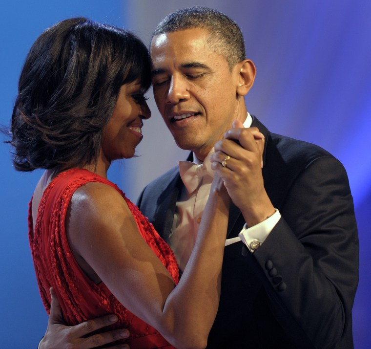 President Barack Obama dances with first lady Michelle Obama during The Inaugural Ball at the Washignton convention center during the 57th Presidential Inauguration in Washington, Monday, Jan. 21, 2013. (Photo by Cliff Owen/AP)