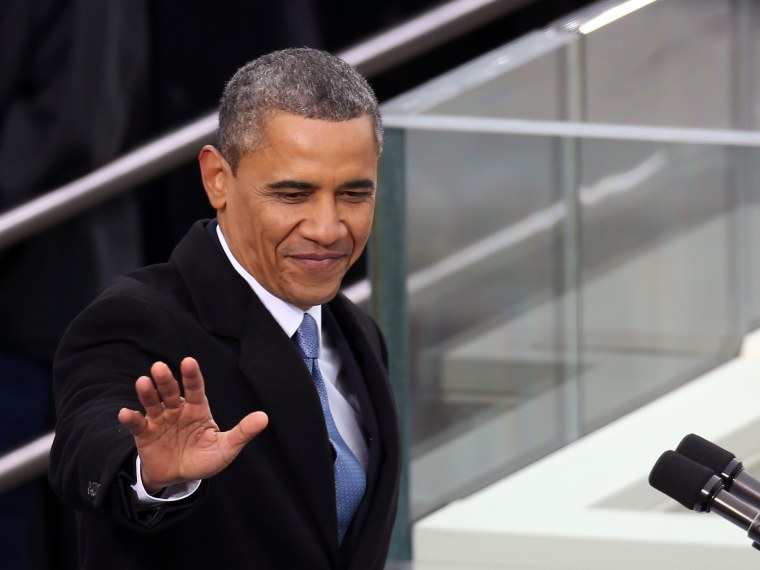U.S. President Barack Obama waves before speaking during the presidential inauguration on the West Front of the U.S. Capitol January 21, 2013 in Washington, DC.   Barack Obama was re-elected for a second term as President of the United States.  (Photo...