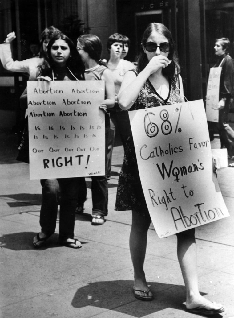 5th July 1973:  Pro-choice campaigners at a demonstration in favour of abortion in front of the American Hotel in mid-town New York, where the American Medical Association is holding its annual convention. The US Supreme Court has ruled that it is a...